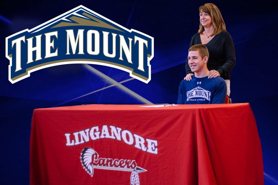 Carter Holsinger is congratulated by his mother after signing his National Letter of Intent.