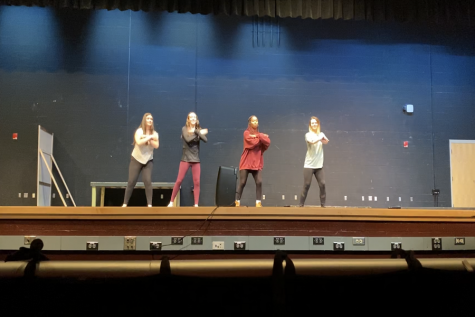 "The ""body"" group performs their dance for the class."