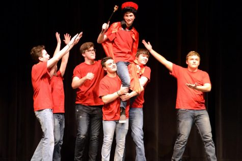 Contestants hold up Braden Weinel in celebration after he's crowned Mr. Linganore