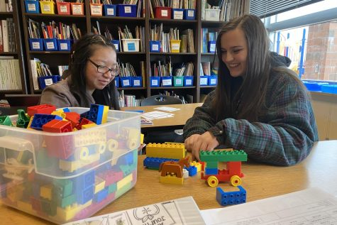 Valerie Ducos and Chloe Bremer play with Mega Blocks.