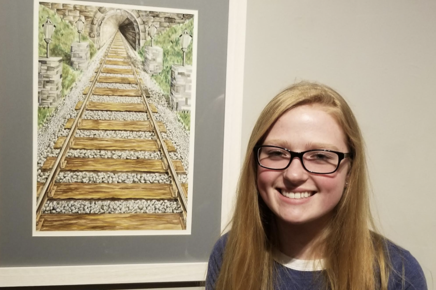 "Suzanna Codd with her painting ""Railroad Tracks."""