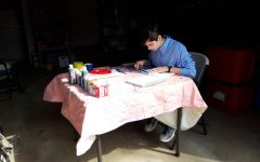 8:00 a.m.: Dana Kullgren uses her garage to work on a project for her art class during the stay-at-home order.