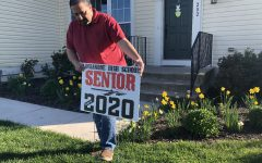 Efren Montenegro displays a Class of 2020 sign to celebrate his daughter Yesenia Montenegro.