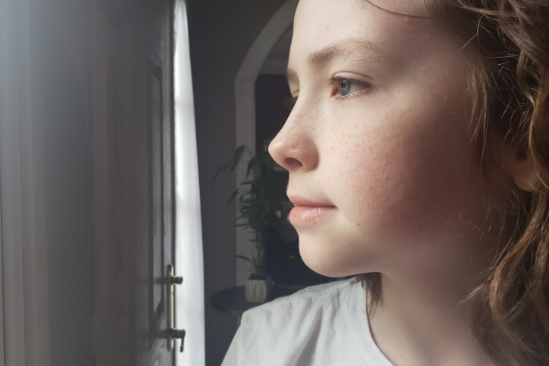 Jack Blundin , who usually plays outside with his friends on warm days, looks outside at his window as, for now, he isn't allowed to see them.