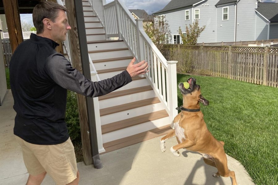 3:00 p.m.: Ken Spore uses his time at home to play with his dog, Floyd.