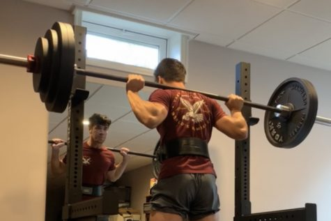 Senior Zach Tilmont squats over 200 pounds. After five months in quarantine, Zach was able to reach his squatting goal.