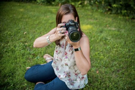 Stacey Markel focuses to get just the right angle for the photo she has in mind.