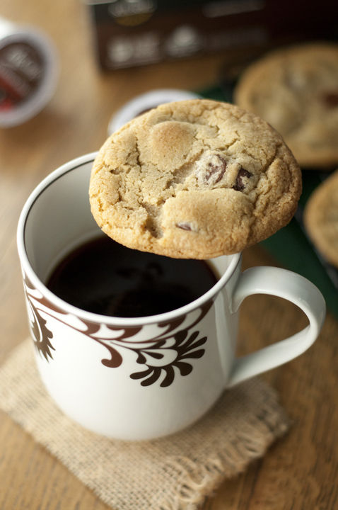 The addictive chocolate coffee cookies sitting on top of a coffee cup