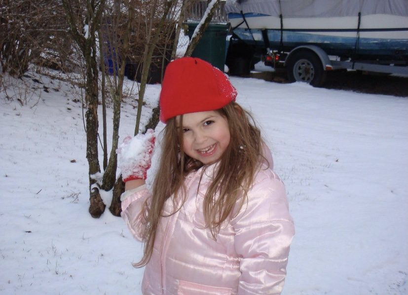5 year old Emily McNally plays in the snow on her day off.