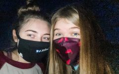 Caroline Hobson and Madeline Hull posing for a picture while wearing face-masks back in March 2020.