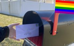 GSA student mailing a letter to their penpal across the county.