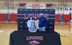Avery Robertson, pictured with her family, signs her National Letter of Intent to play lacrosse at the Naval Academy.
