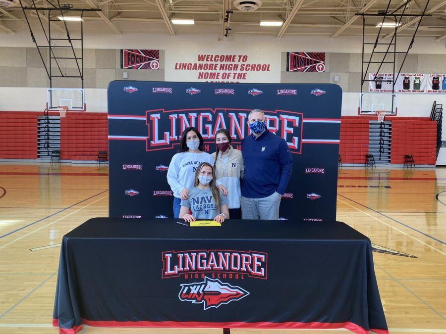 Avery+Robertson%2C+pictured+with+her+family%2C+signs+her+National+Letter+of+Intent+to+play+lacrosse+at+the+Naval+Academy.