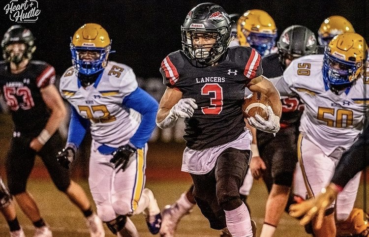 Xander McClure carries the ball to lead his team home to victory against the opponents from Walkersville.