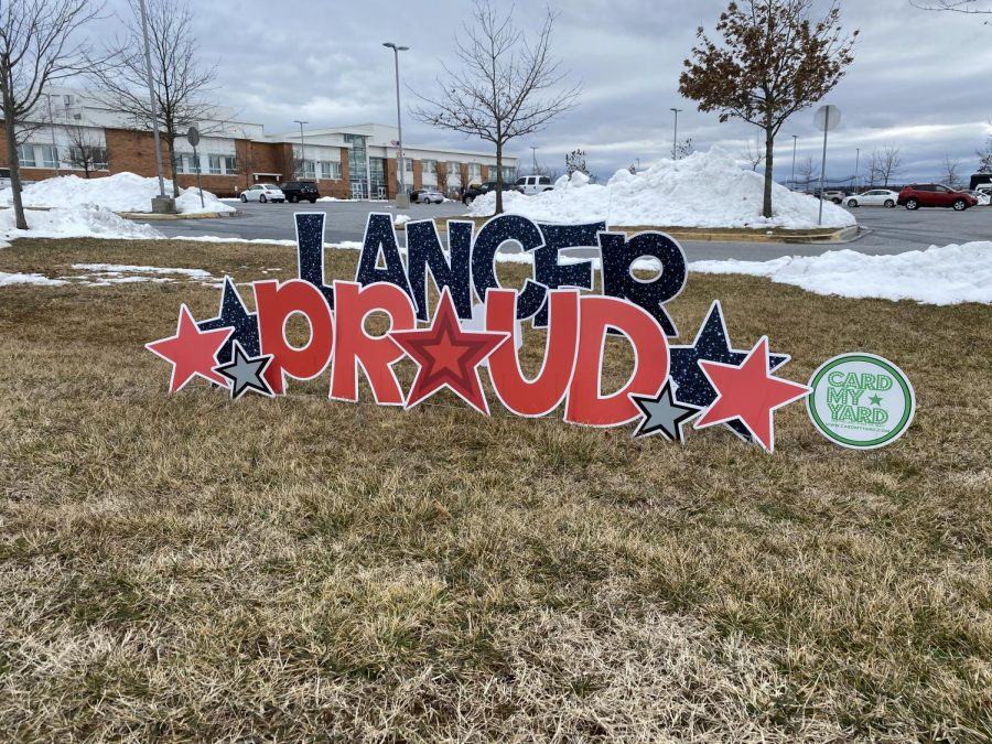 """Lancer Proud"" Card My Yard sign staked outside of Linganore High School for the first day of hybrid learning."