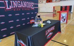 Each athlete had their own individual ten-minute time slot to hear their coach's speech, sign their National Letter of Intent and take pictures. Samantha Hoefs signed to Randolph-Macon. She celebrated with her immediate family--smiling through her required mask.