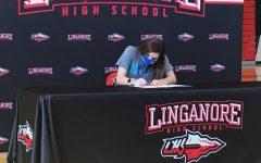 Elizabeth Rajnik signs her National Letter of Intent on signing day.