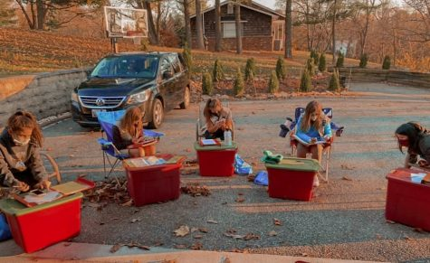 Girl Scouts gather together for their planning meeting while following social-distance guidelines.