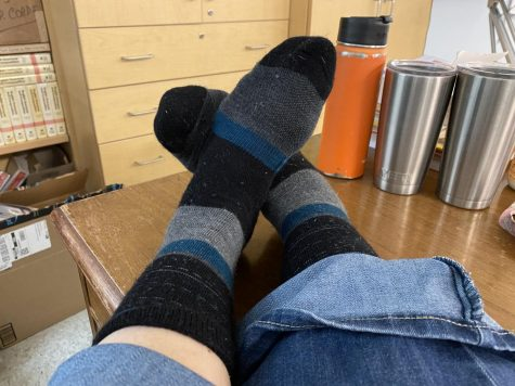 #LotsofSocks: Mrs. Rebetsky shows of her striped socks for World Down Syndrome Day.