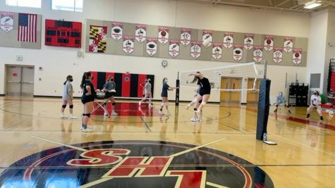 Junior varsity player, Katie Heely going in for the spike during practice.