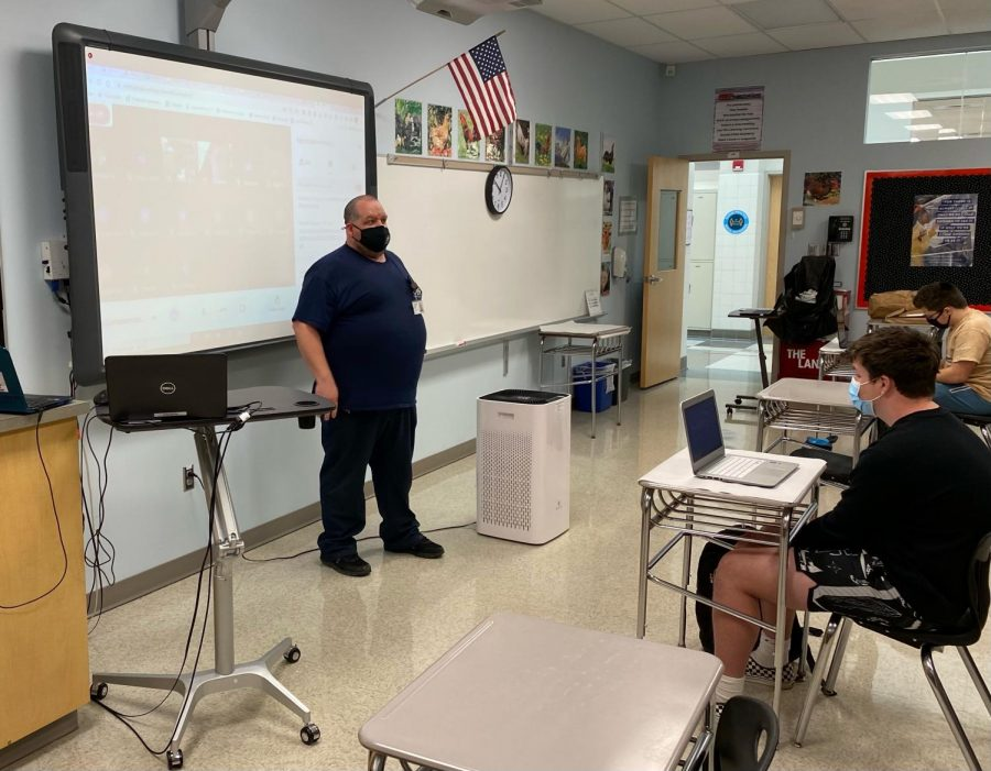 Mr. Mike Bowles speaking to Mrs. Rebetsky's journalism class.