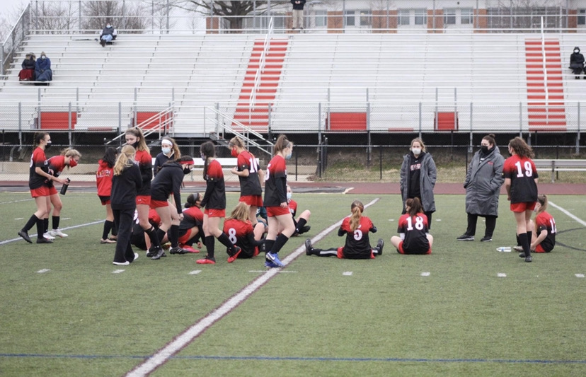 The JV girls soccer team during halftime of their home game on March 11, 2021 against Brunswick.
