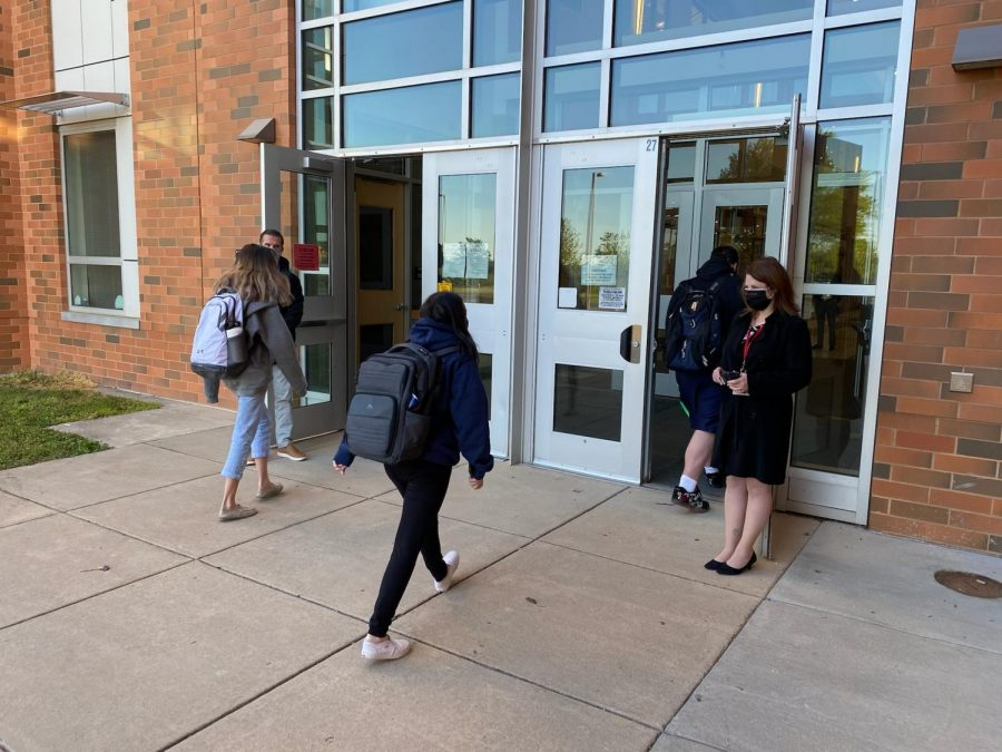Hanlon holds the school doors open for students in the mornings.