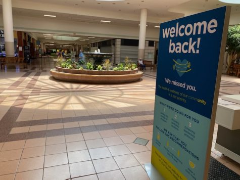 """A close view of the deserted center of the FSK Mall... with its ironic """"Welcome Back"""" sign."""