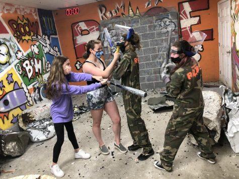 Seniors Ella Haskins, Gabby Thompson, Elizabeth Rajnik, and Tabitha Knedeisen vent their anger at Room of Rage.