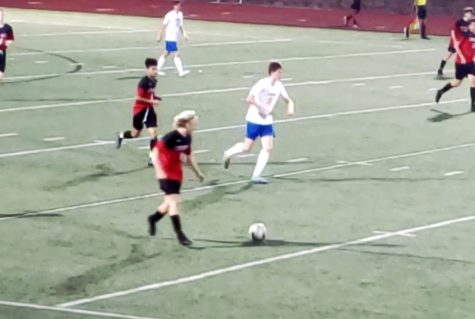 Sophomore Brady Densock dribbles the ball up the field.