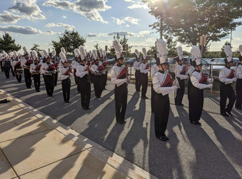 The Linganore Marching band gets ready to march down to the stadium before the first football game of the season.