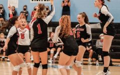 The varsity volleyball team celebrates a point earned during the game.  The opponent was Westminster High.