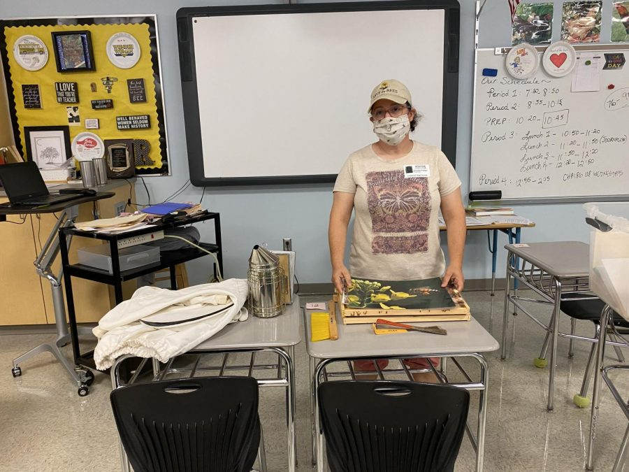 Beekeeper Jennifer Pralgo demonstrates some aspects of beekeeping.