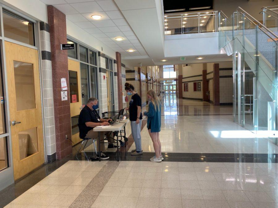 Jeremy Brown sells Homecoming tickets to students.