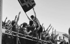Member of the tribe Brady Brouillard, raises the LHS flag above the students to get everyone into the Lancer Spirit.
