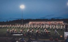 How does the band achieve perfection? Its simple, dedication to each individual detail. Standing in formation, marching with a roll step, and attending hours of band practice are just a few key steps that help them reach greatness.
