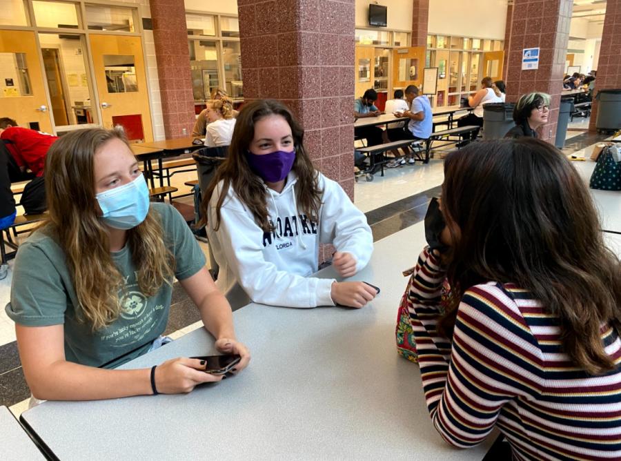 Peyton MacAnanny, Maya Soisson and Chloe Kim converse during their new lunch shift