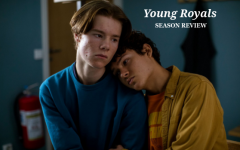 Main characters Simon and Prince Wilhelm featured in Young Royals, are shown having a candid moment, embracing each other while they face the consequences of being in the public eye.