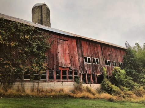 Jackson Enos takes a picture of a old barn