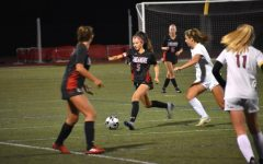 Senior and captain Victoria Garofolo (#5) putting her all into one of the last girls varsity soccer game of the season.