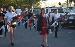 Emily Watson leads marching band towards the stadium, getting ready for the pep rally.