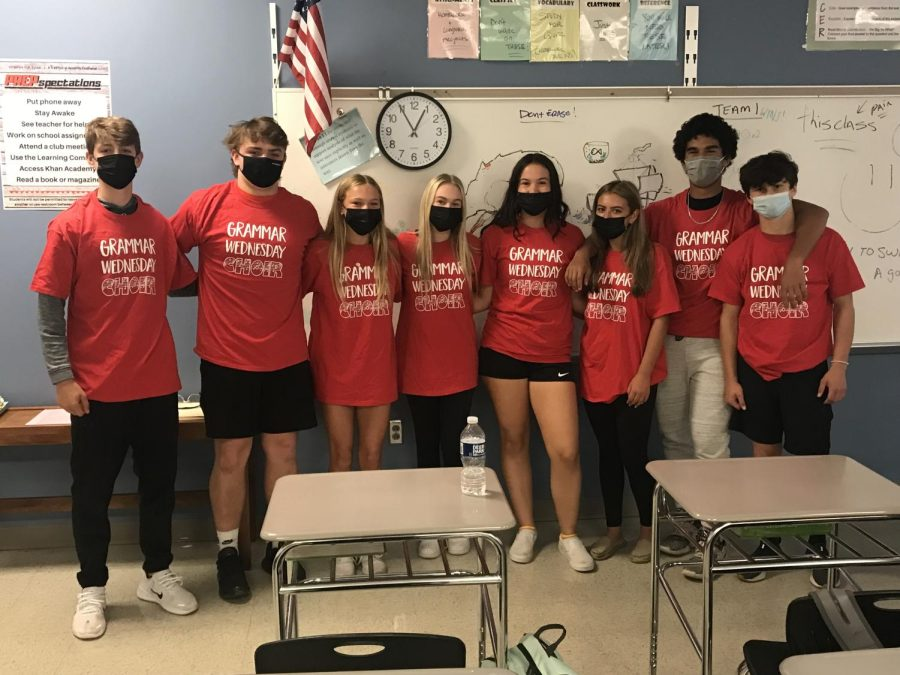 Going left to right, Brian Blum, Greg Ayres, Reese Wallich, Kaitlin Weis, Grace Booth, Madison Madariaga, Giacomo McCadney and Hunter Davis show off their Grammar Wednesday shirts.
