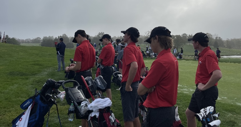Seniors Sam Johnson, Ethan Crabb, , Bradley Rose, Austin May, and Junior Logan Perish watch their teammates perform.
