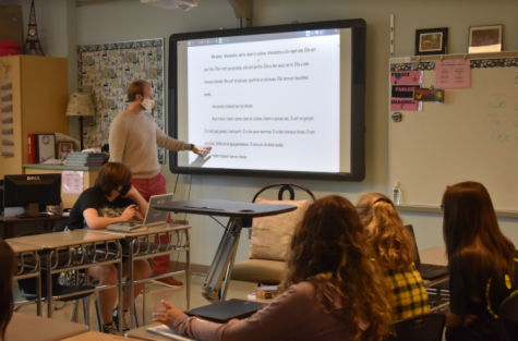 Long-term substitute Jacob McCrary reads a story to his French 1 students to help with reading comprehension.